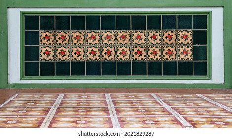 Decorative ceramic peranakan tile mosaic on the shop frontage of a traditional chinese shophouse.