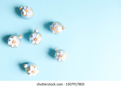 A lot of decorative Christmas balls on menthol background.