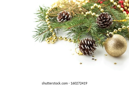 Decorative christmas composition isolated on white. Holiday postcard -  spruce, beads, pine cones. Selective focus.