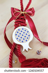 decorative Christmas lucky pomegranate with red ribbons - traditional greek lucky charms