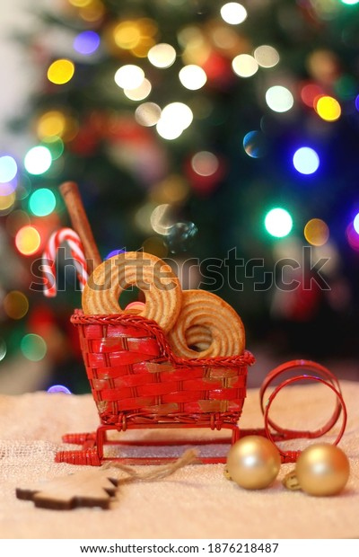 Decorative Christmas sleigh filled with cookies. Selective focus.