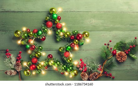Decorative Christmas Star with colored baubles, christmas tree branches 