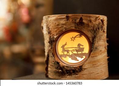 Decorative Christmas tea light depicting Santa on a reindeer sleigh at a Christmas Market