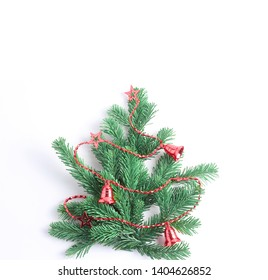 Decorative Christmas tree decorated with red beads. Flat lay, minimal concept, square frame