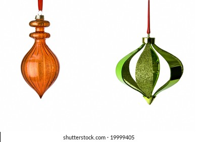 Decorative Christmas Tree Ornaments hanging from red ribbons isolated on white background with clipping path. Lots of room for copy.