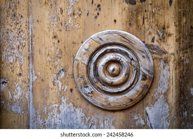 Decorative circle on an old wooden door. Horizontal composition