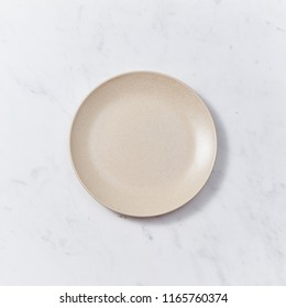 Decorative clay dish, covered with glazed on a gray background with copy space. Can be used for display or montage your products.