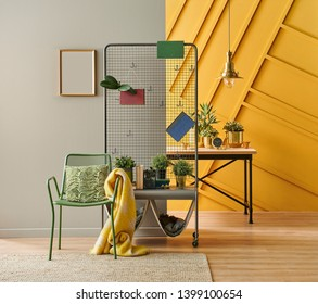 Decorative close up metal hunger style in the room with frame chair and wooden table style, brown and yellow wall.