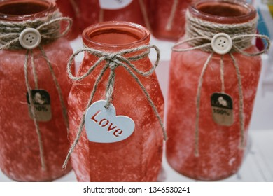 decorative colored orange bottles with the inscription love, handmade