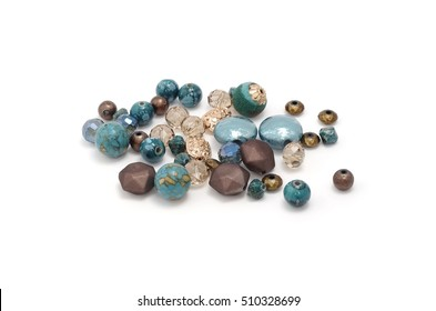 Decorative colorful beads scattered on white background - accessories for handmade and hobby
