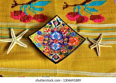 decorative colorful ceramic plates artefacts  star fish
