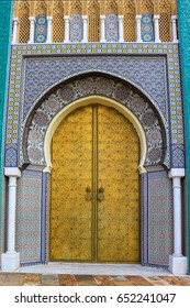 Decorative and colorful doorway with patterns of masaic tiles in Morocco, Africa