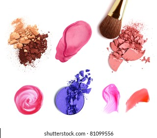Decorative cosmetic samples isolated on white. Lipstick, lip gloss, eyeshadow, spilling.