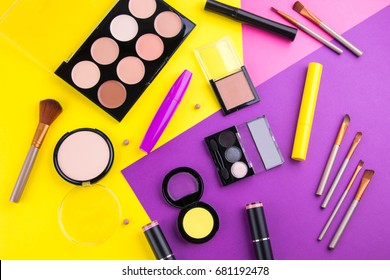 Decorative cosmetic set on colourful background