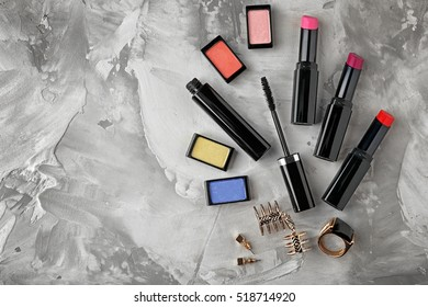 Decorative cosmetic set on grey textured background