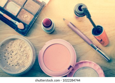 Decorative cosmetics and accessories for makeup on wooden backgr