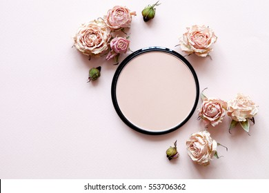 Decorative cosmetics background with flowers, top view