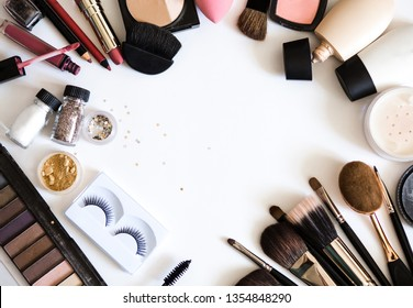Decorative cosmetics for beauty make up. Nude pallet. brushes, lipstic, lashes, mascara, skin BB cream, tone, powder, highlighters, contour on white background top view
