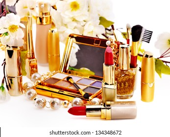 Decorative cosmetics and flower. Isolated.
