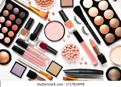 Decorative cosmetics and makeup brushes on a white background, top view - Shutterstock ID 1717814998