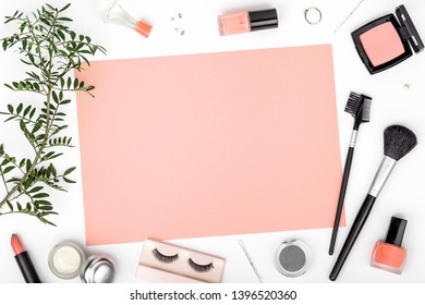decorative cosmetics, makeup tools and accessory on white background with copy space for text. color of year 2019 Living Coral. beauty, fashion, party and shopping concept. flat lay frame composition