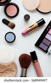 Decorative cosmetics on white background top view