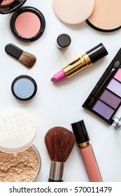 Decorative cosmetics on white background, top view