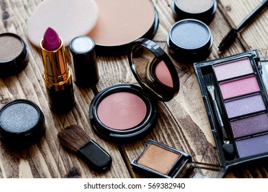 Decorative cosmetics on wood background, top view