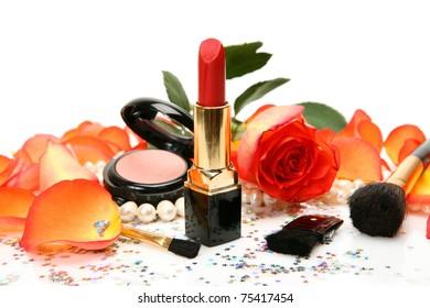 Decorative cosmetics and petals of roses