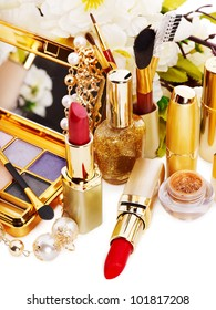 Decorative cosmetics and spring flower. Isolated.