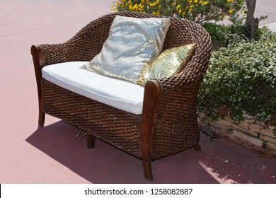 a decorative couch in a garden