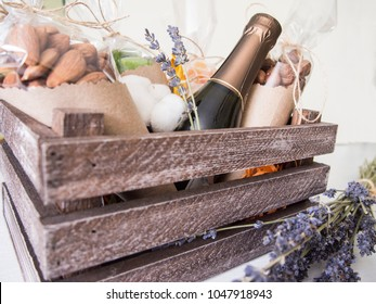 decorative crate with nuts, dried fruits, cotton and lavender
