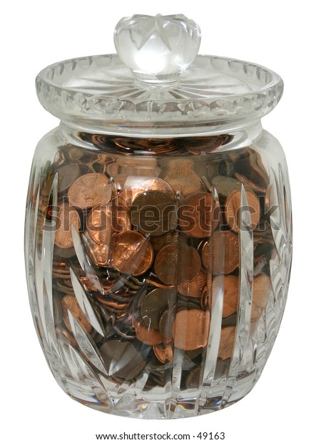 Decorative crystal jar of pennies isolated on white.