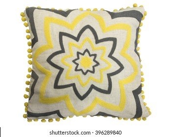 Decorative cushion with geometrical pattern of yellow and black threads embroidered. Isolated on white background.