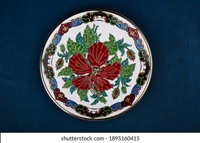 Decorative Cyprus ceramic plate handmade with floral ornament, close up: Zhukovsky, Russia - January 16, 2021