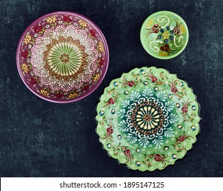 Decorative Cyprus ceramic plates with floral ornament, painted plate, flat lay, vintage styling, handmade: Zhukovsky, Russia - January 13, 2021