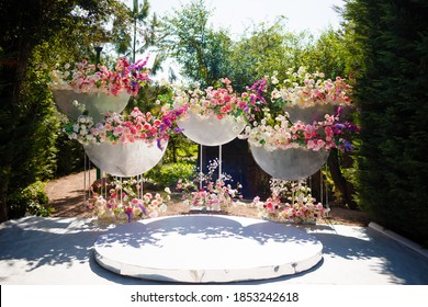 Decorative design of a wedding arch with flowers.
