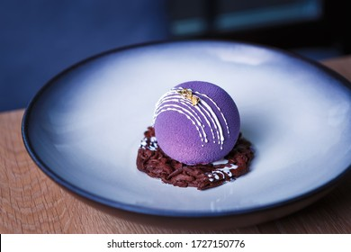 Decorative dessert food.Beautiful purple cake decorated with chocolate swarf served on round plate in Italian restaurant.Delicious desserts,pastry for snack meal.Enjoy desserts cooked in Italy - Shutterstock ID 1727150776