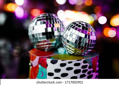 Decorative disco balls on party background