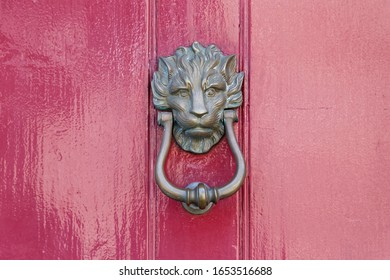 decorative door knocker on a historic building