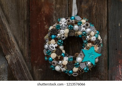 Decorative door wreath on old wooden background