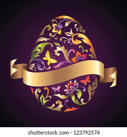 decorative Easter egg with engraved and painted pattern and blank golden ribbon banner