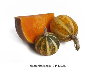 Decorative and edible pumpkins on a white background