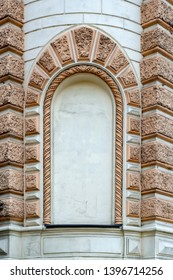 Decorative element in the form of a stone fake window at the corner of the building