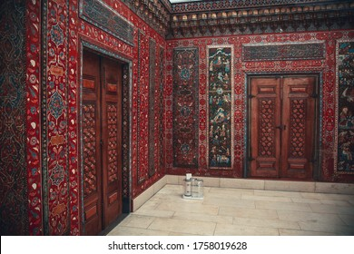 Decorative element. Macro close up. Carving oriental stone wall and carving wooden arch door Marrakech, Morocco