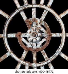 The decorative element of the old centennial rusty metal gate -  symbol of the sun. Isolated on black with patch