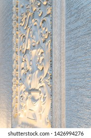a decorative element from a plaster molding on the wall of the facade