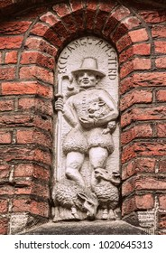 Decorative elements on the buildings in Amsterdam. Architecture of Holland.