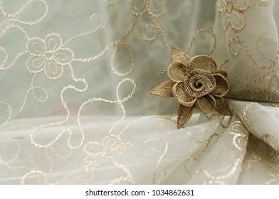 decorative fabric flower on transparent tulle