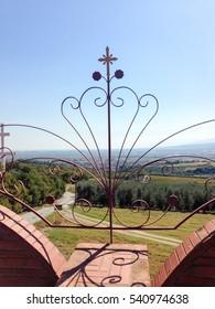 Decorative fence accessories on landscape background. St. Ephrem the Syrian monastery, Kondariotissa, Pieria, Greece.